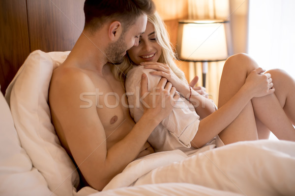 Loving couple on the bed Stock photo © boggy