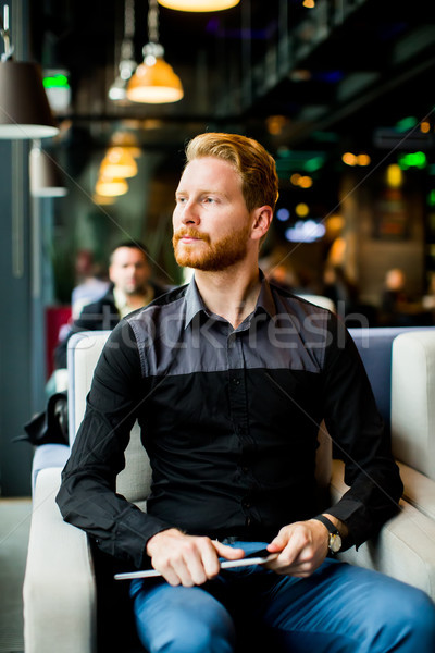 Young man with tablet Stock photo © boggy