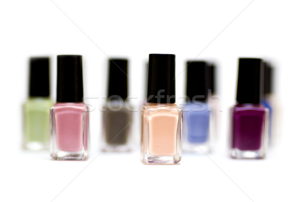 Coloured nail polish bottles on a white background Stock photo © boggy