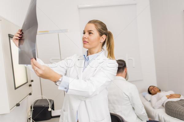 Radiologist lokking at x-ray in a clinic medical lab Stock photo © boggy