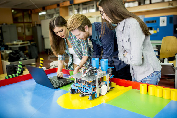 Young people in robotics classroom Stock photo © boggy