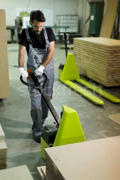 Male worker working in furniture industry Stock photo © boggy