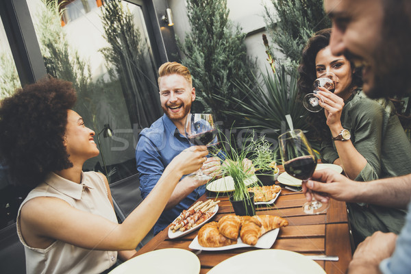 Young people enjoy the food and drink and have great fun outdoor Stock photo © boggy