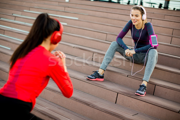 Attractive woman exercising with a personal trainer outside in t Stock photo © boggy