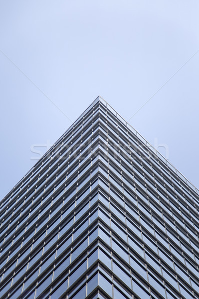 Modern glass facade of an office building in Tokyo Stock photo © boggy