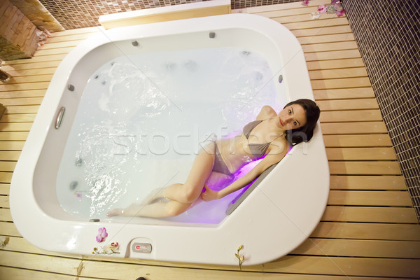 Girl in a hot tub Stock photo © boggy