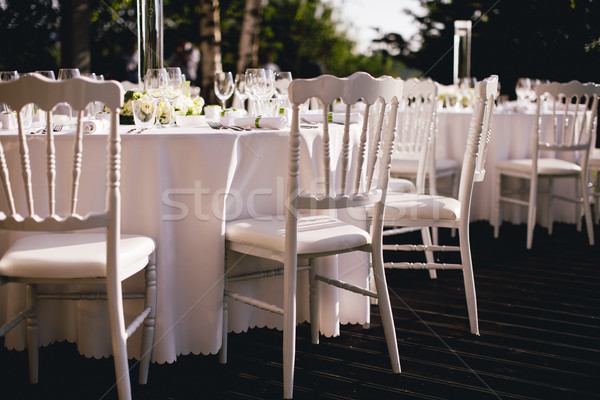 Exquisitely decorated wedding table with bouquet of roses Stock photo © boggy