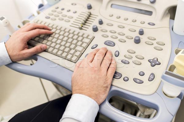 Doctor working on ultrasounds keyboard Stock photo © boggy