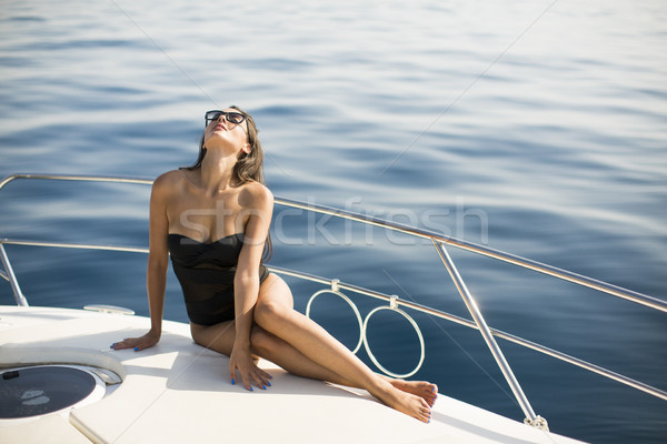 Pretty young woman relaxing on the yacht Stock photo © boggy