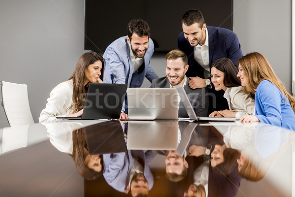 Young successful managers discussing new business project Stock photo © boggy