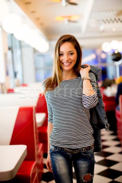 Mulher diner ver bastante mulher jovem posando Foto stock © boggy