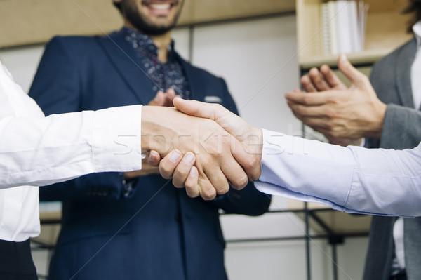 Businesswomen handshaking after deal agreement Stock photo © boggy