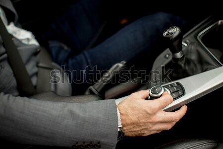 Young man n the car changing gears Stock photo © boggy