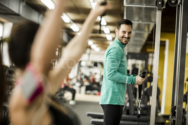 Exercice bodybuilding gymnase modernes femme Photo stock © boggy