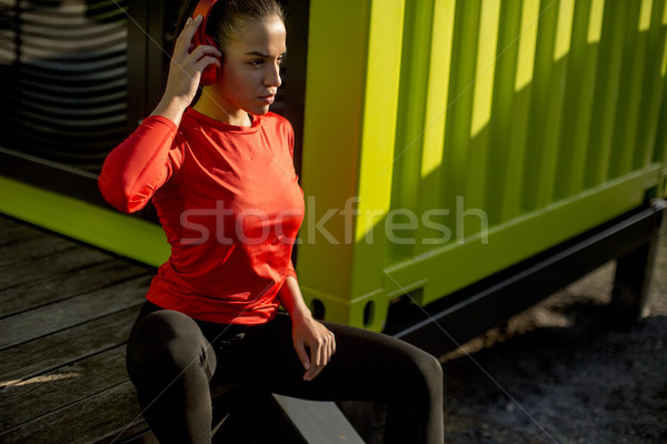 Young attractive female  runner taking break after jogging outdo Stock photo © boggy