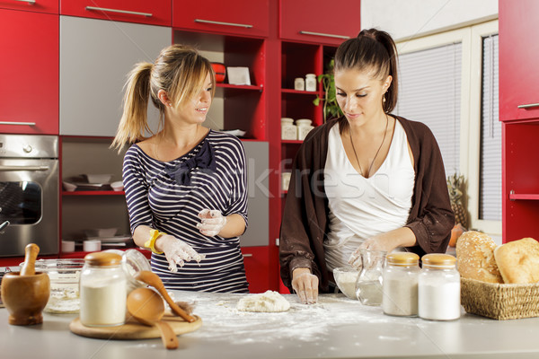 Young women in the kitchen Stock photo © boggy