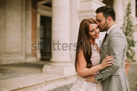 tourist couple on travel by Trevi Fountain in Rome, Italy. Stock photo © boggy