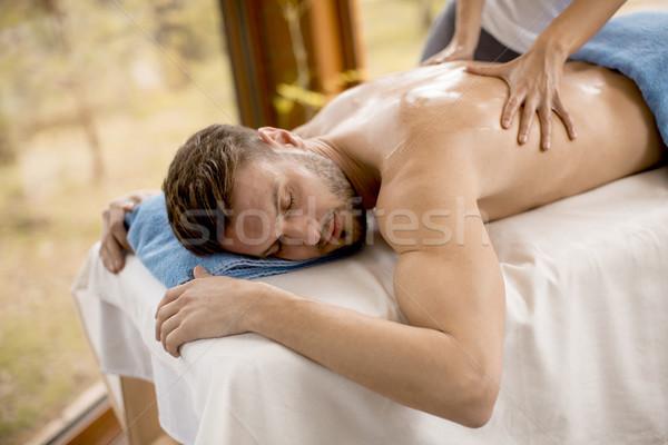 молодым человеком массаж Spa расслабиться нефть человек Сток-фото © boggy
