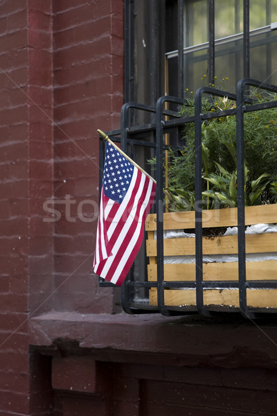 American flag on traditional buiding in New York City Stock photo © boggy