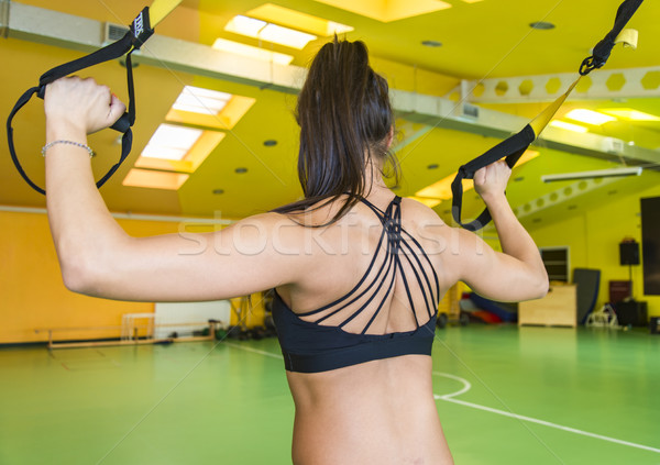 Young woman doing suspension training Stock photo © boggy