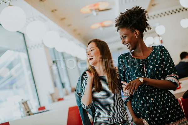 Young multiethnic women in the diner Stock photo © boggy