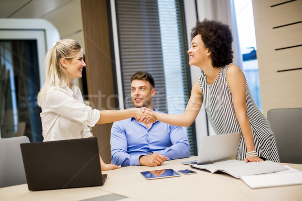 Two young businesswomen shaking hands after a job well done Stock photo © boggy