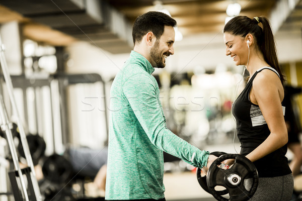 Woman and trainer in the gym Stock photo © boggy