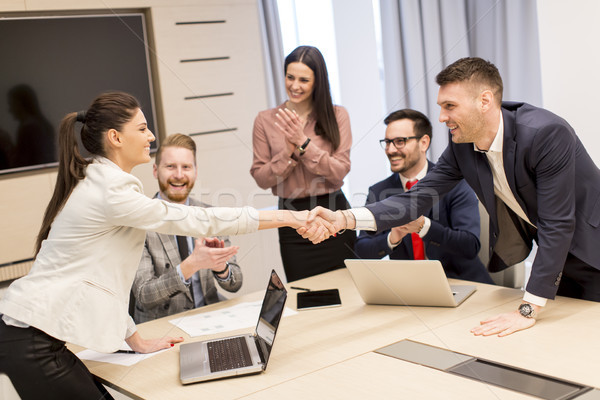 Stock photo: Young business people working together in office