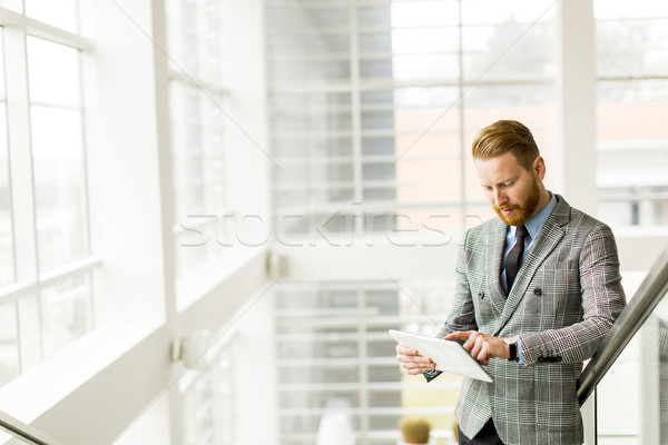 Portré fiatal üzletember tart digitális tabletta Stock fotó © boggy
