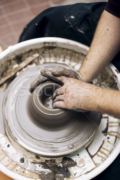 Sanatçı kil çanak çömlek dönüş tekerlek Stok fotoğraf © boggy