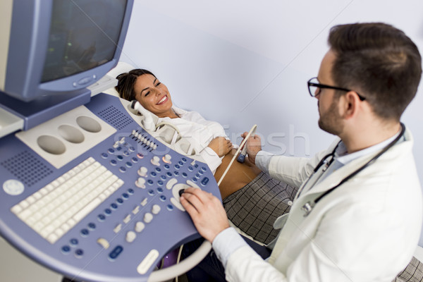 Doctor  doing medical examination of patient with ultra sound Stock photo © boggy