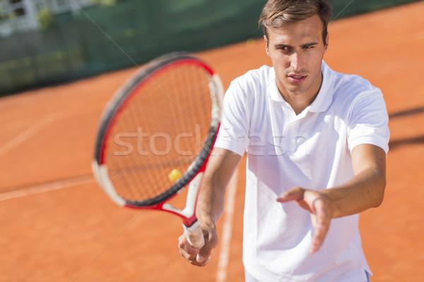 Jonge man spelen tennis zomer jonge opleiding Stockfoto © boggy