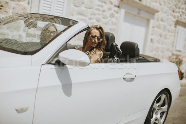 Las mujeres jóvenes blanco cabriolé coche conducción dos Foto stock © boggy
