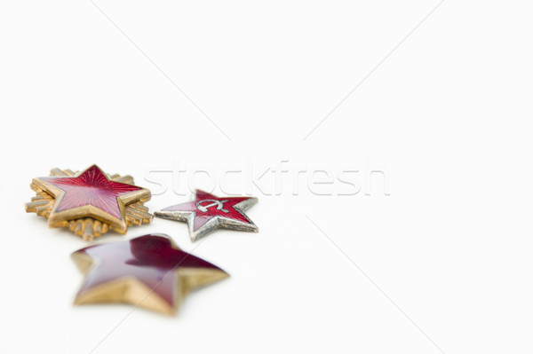 Old red stars from military caps isolated on the white backgroun Stock photo © boggy