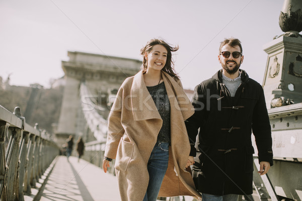 Loving couple on Chain bridge, Budapest Stock photo © boggy