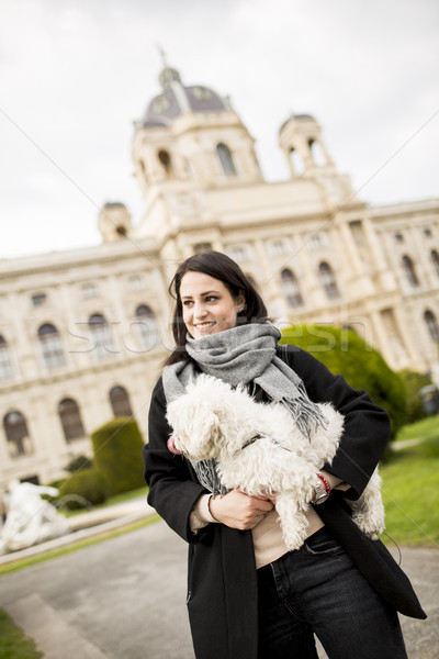 Beautiful happy young woman with cute small dog puppy have fun o Stock photo © boggy