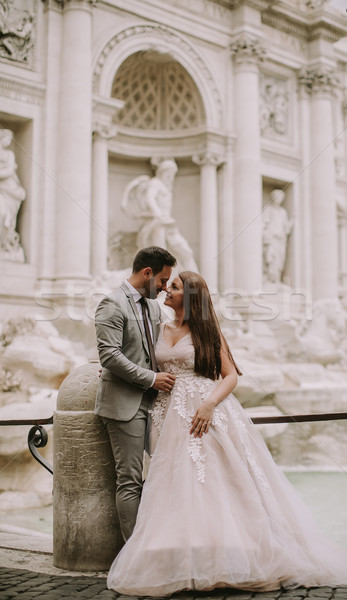 Bride and groom posing in front of Trevi Fountain (Fontana di Tr Stock photo © boggy
