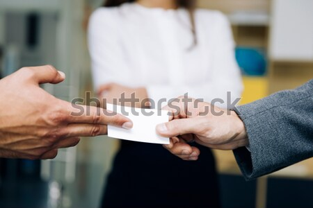 Closeup of businesspeople exchanging business card Stock photo © boggy