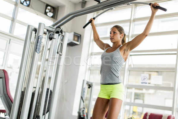 Young woman training in the gym Stock photo © boggy