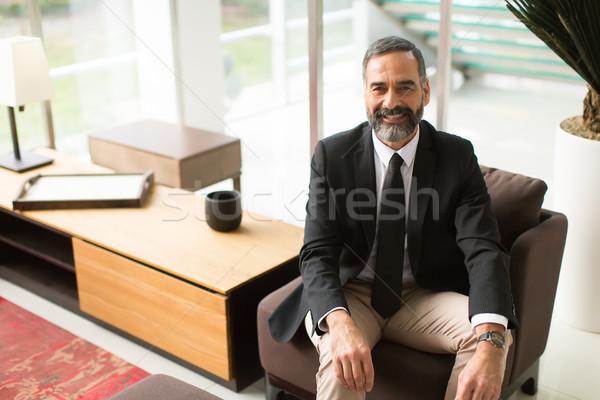 Jóképű üzletember ül lobbi portré szék Stock fotó © boggy