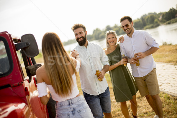 Young people drinking and having fun by car Stock photo © boggy