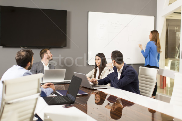 Young successful managers discussing new business project in mod Stock photo © boggy
