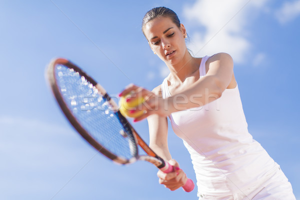 Young woman playing tennis Stock photo © boggy