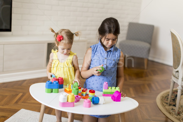Two little girls playing with toys in the room Stock photo © boggy