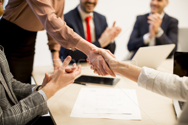 Business people shaking hands  finishing up a meeting in office Stock photo © boggy