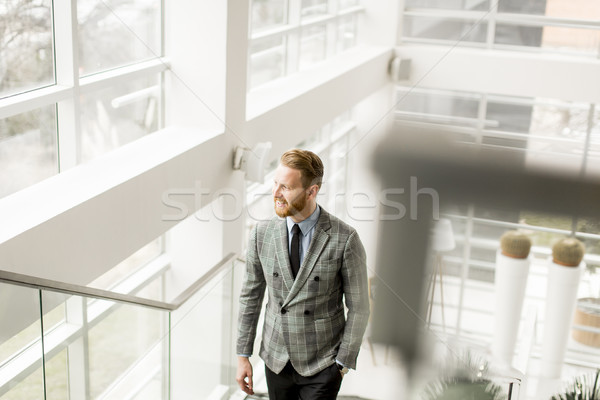 Redhair businessman on stairs Stock photo © boggy