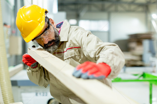 Middle aged worker working in the furniture factory Stock photo © boggy
