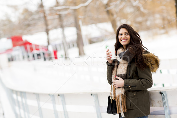 Happy woman with a cup of hot drink on  cold winter outdoors Stock photo © boggy