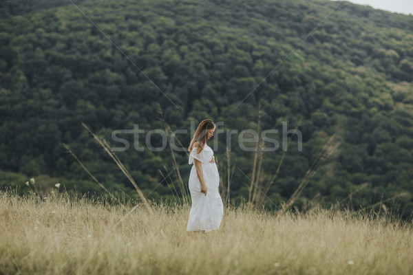 Young pregnant woman relaxing outside in nature Stock photo © boggy