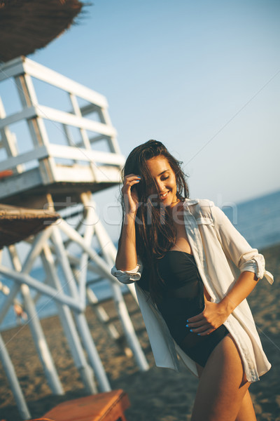 Young woman posing on the beach Stock photo © boggy